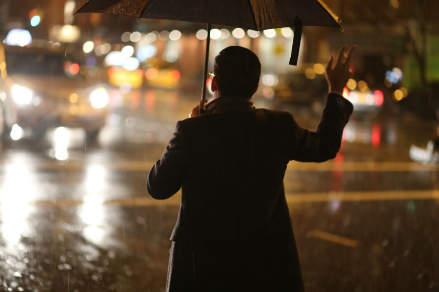 Kashkore: A New York Man Hails a Cab on a Rainy Day
